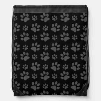 Impresión de la pata del perro negro mochilas