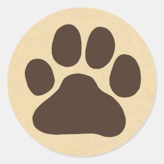 Impresión de la pata del perro pegatina redonda