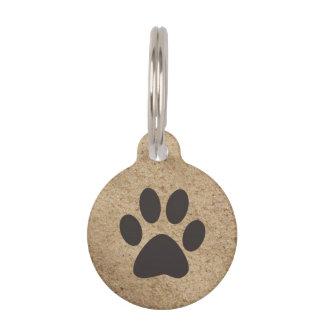 Impresión de la pata en etiqueta del mascota de la placas de mascota