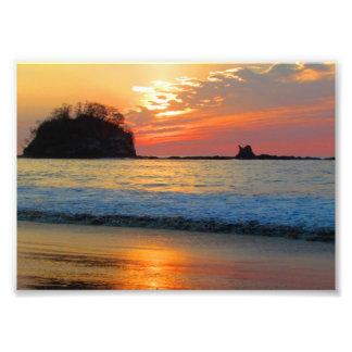 Impresión de la puesta del sol de la playa de Cost Cojinete