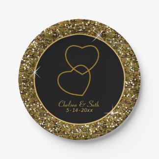Impresión del confeti del brillo del oro con los platos de papel