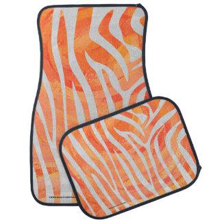 Impresión del naranja de la cebra y blanca alfombrilla de auto