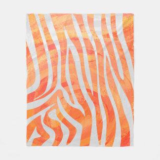 Impresión del naranja de la cebra y blanca manta de forro polar