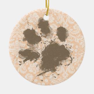 Impresión divertida de la pata en el albaricoque adorno redondo de cerámica