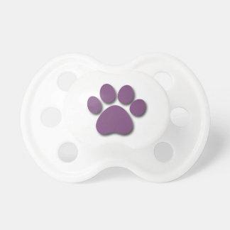 Impresión juguetona de la pata del perro para el chupetes de bebe