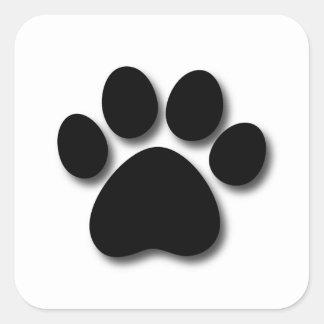 Impresión juguetona de la pata del perro para el pegatina cuadrada