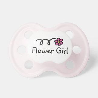 Impresión rosada femenina de la margarita del paci chupete de bebe
