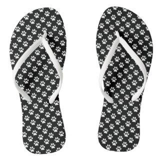 Impresiones animales blancas de la pata en negro
