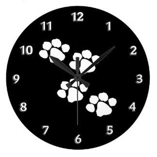 Impresiones animales de la pata reloj de pared