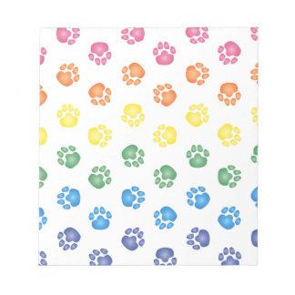 Impresiones coloridas de la pata bloc de notas