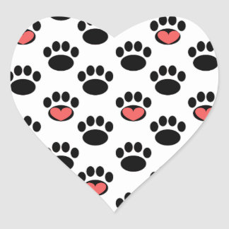 Impresiones de la pata con los corazones pegatina en forma de corazón
