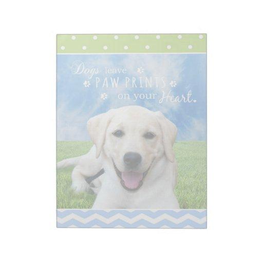 Impresiones de la pata de la licencia de los perro bloc de notas