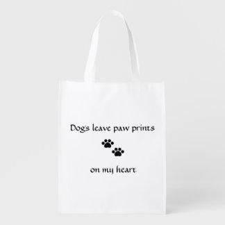 Impresiones de la pata de la licencia de los perro bolsas reutilizables