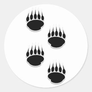 Impresiones de la pata de oso negro pegatina redonda