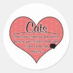 Impresiones de la pata del gato en su humor del etiqueta redonda