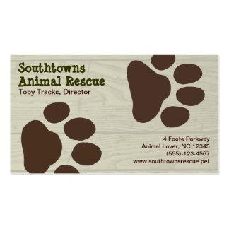 Impresiones de la pata del perro en el fondo de ma tarjetas de visita