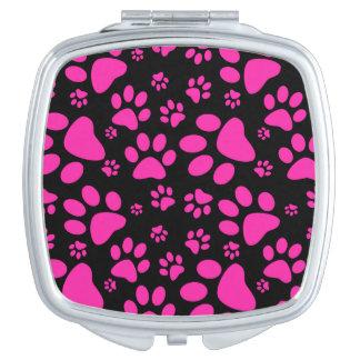 Impresiones rosadas y negras de la pata espejos compactos