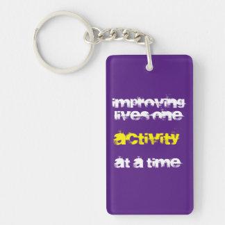 """Improving Lives..."" (rectangular version) Keychain"