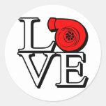 Impulse el amor etiqueta redonda