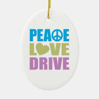 Impulsión del amor de la paz adorno navideño ovalado de cerámica