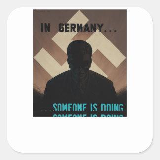 In Germany... someone is_Propaganda Poster Square Sticker