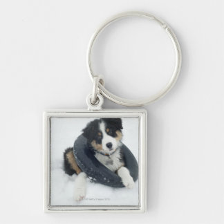 in inner tube in the snow Silver-Colored square keychain