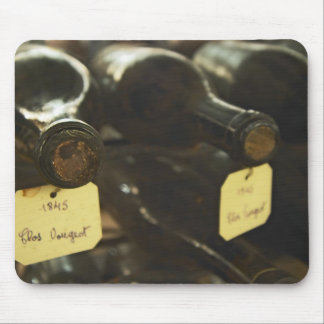 In the underground wine cellar: lying bottles in mouse pad