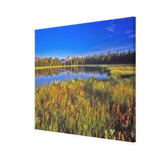 Index Peak reflects into Mud Lake on the Canvas Print
