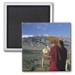 India, Ladakh, Thikse. Buddhist monk blows 2 Inch Square Magnet