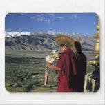 India, Ladakh, Thikse. Buddhist monk blows Mouse Pads