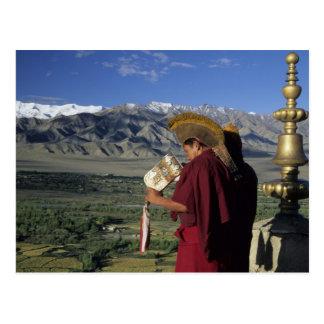 India, Ladakh, Thikse. Buddhist monk blows Postcard