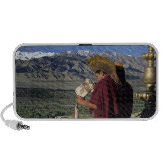 India, Ladakh, Thikse. Buddhist monk blows Speakers