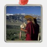 India, Ladakh, Thikse. Buddhist monk blows Square Metal Christmas Ornament
