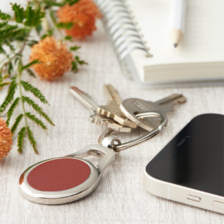 Indian Red colored Silver-Colored Oval Metal Keychain