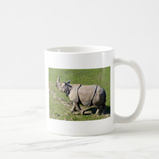 Indian rhinoceros on grass coffee mug