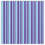 [ Thumbnail: Indigo and Sky Blue Pattern of Stripes Fabric ]