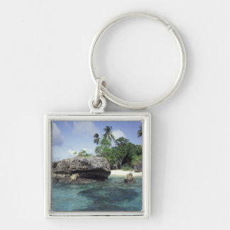 Indonesia. Rock formations along shore Keychain