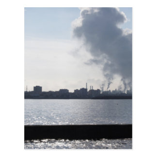 Industrial landscape along the coast Air polluting Postcard