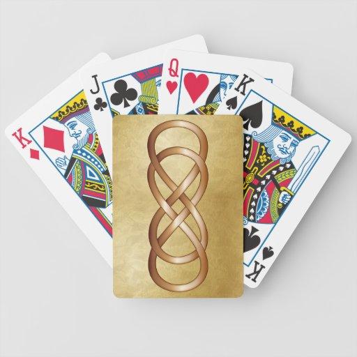 Infinito doble de bronce en el oro barajas de cartas