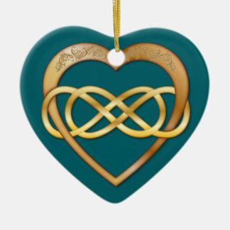 Infinito doble entrelazado de los corazones - oro ornato