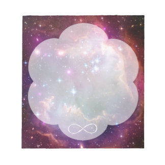 Infinity loop and galaxy space hipster background note pad