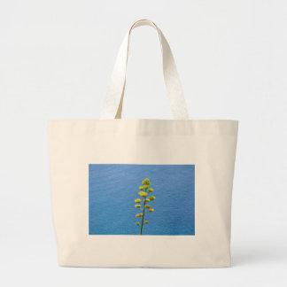 Inflorescencia de una planta del agavo bolsas de mano