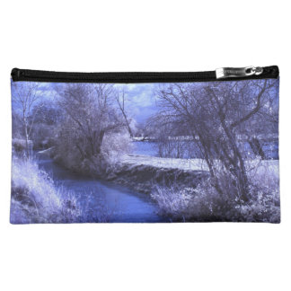 Infrared landscape with stream in blue cosmetic bag