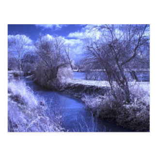 Infrared landscape with stream in blue postcard