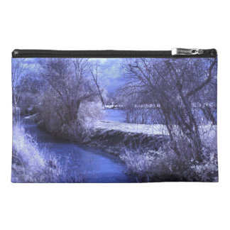 Infrared landscape with stream in blue travel accessory bag