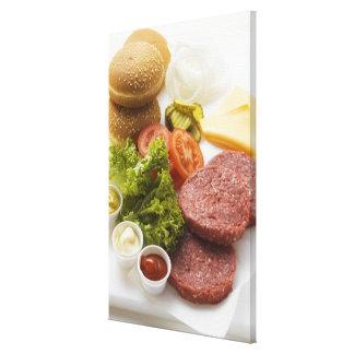 Ingredientes para los cheeseburgers impresión en lona estirada