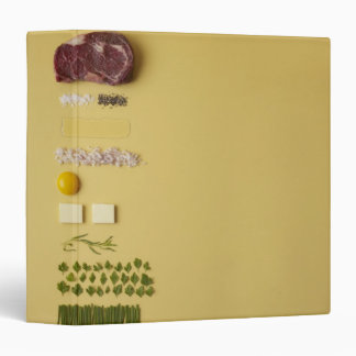 Ingredients for steak tartare on yellow binder