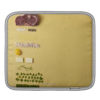 Ingredients for steak tartare on yellow iPad sleeve