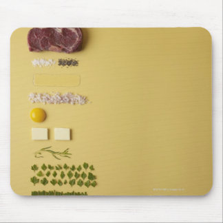 Ingredients for steak tartare on yellow mouse pad