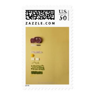 Ingredients for steak tartare on yellow postage
